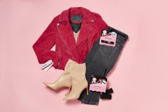A woman blazer, pants, and boots with 3-pieces Hollywood fashion secrets item on top